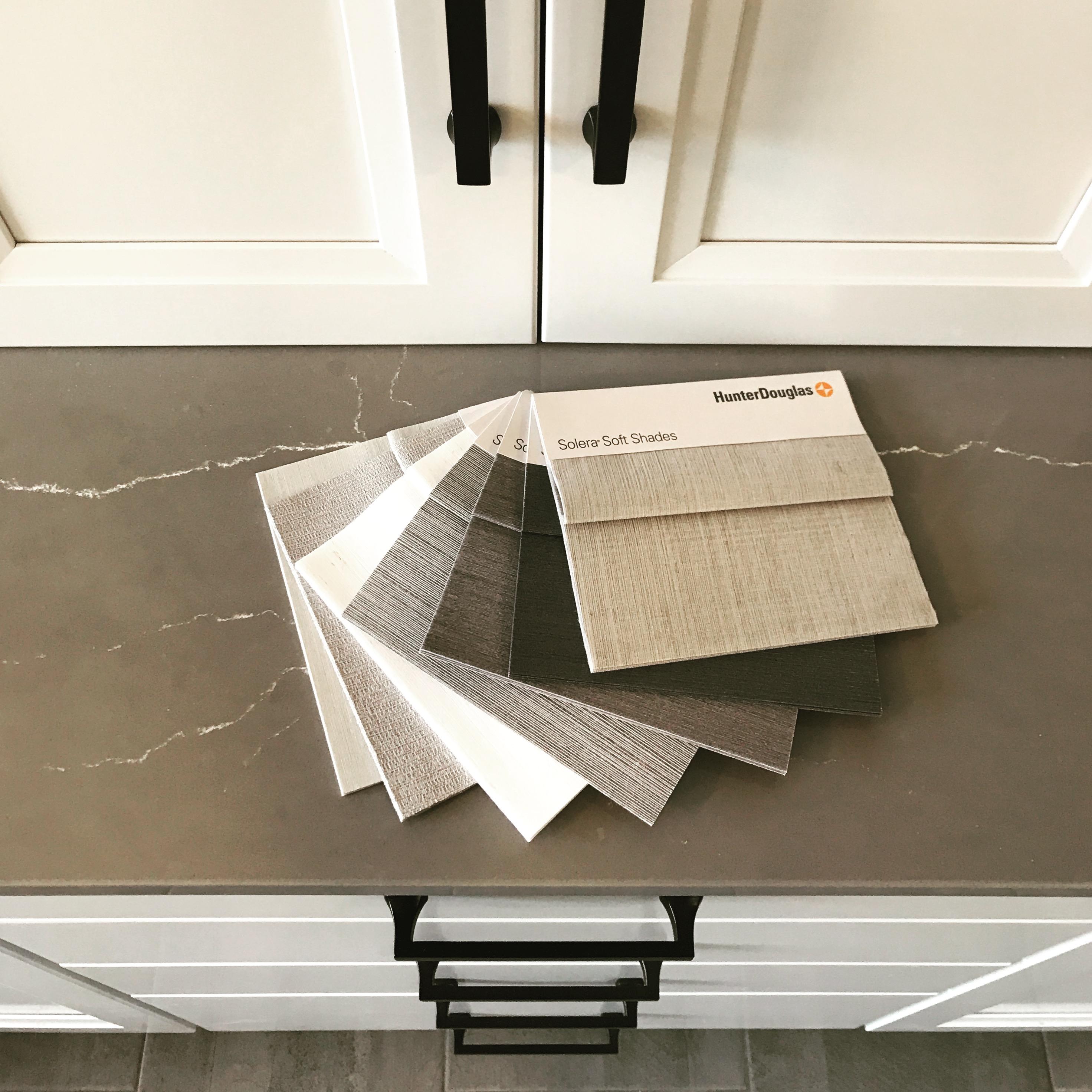 gray countertop with white vanity black hardware shade fabric samples