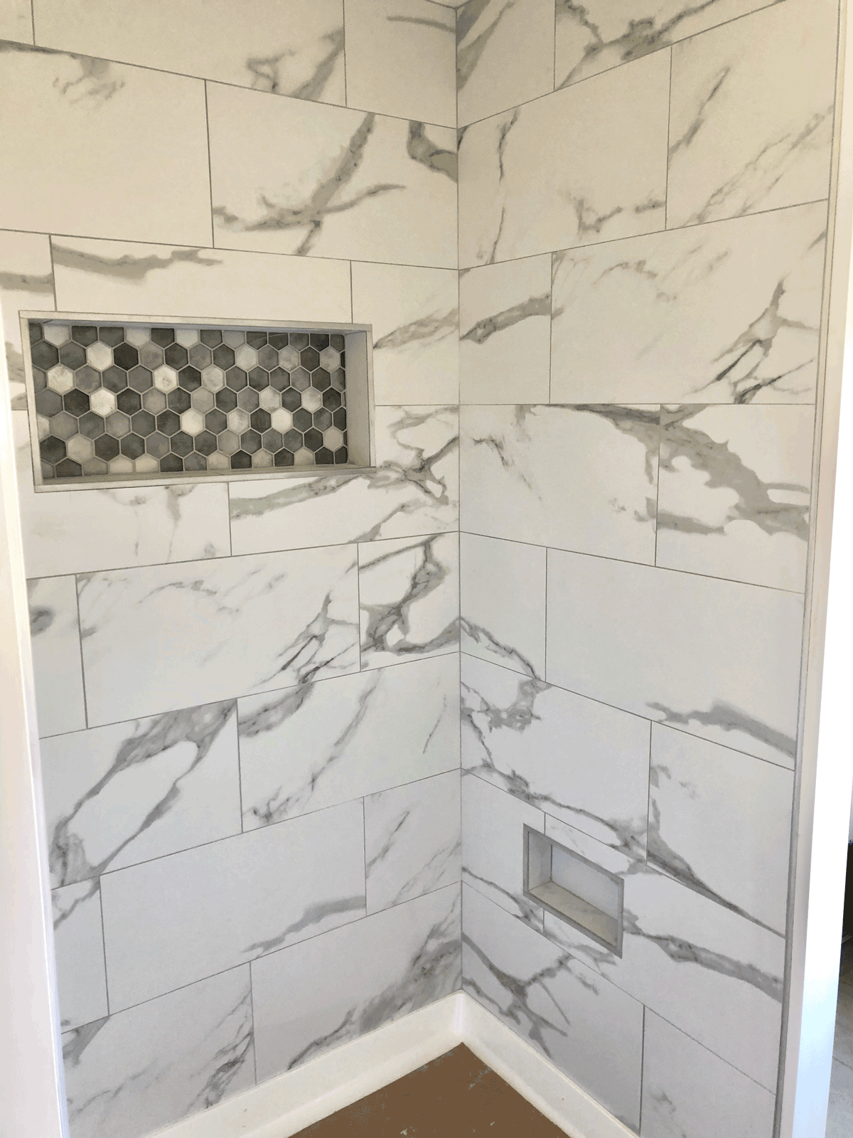 newly installed marble tile in shower stall white gray marble