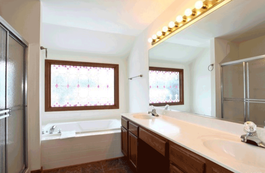 outdated master bathroom stained glass window built in tub