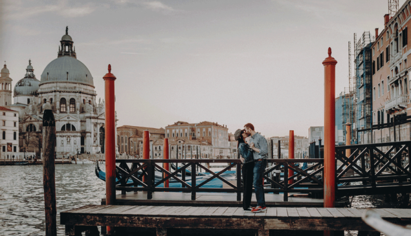 couple dancing on pier in venice italy