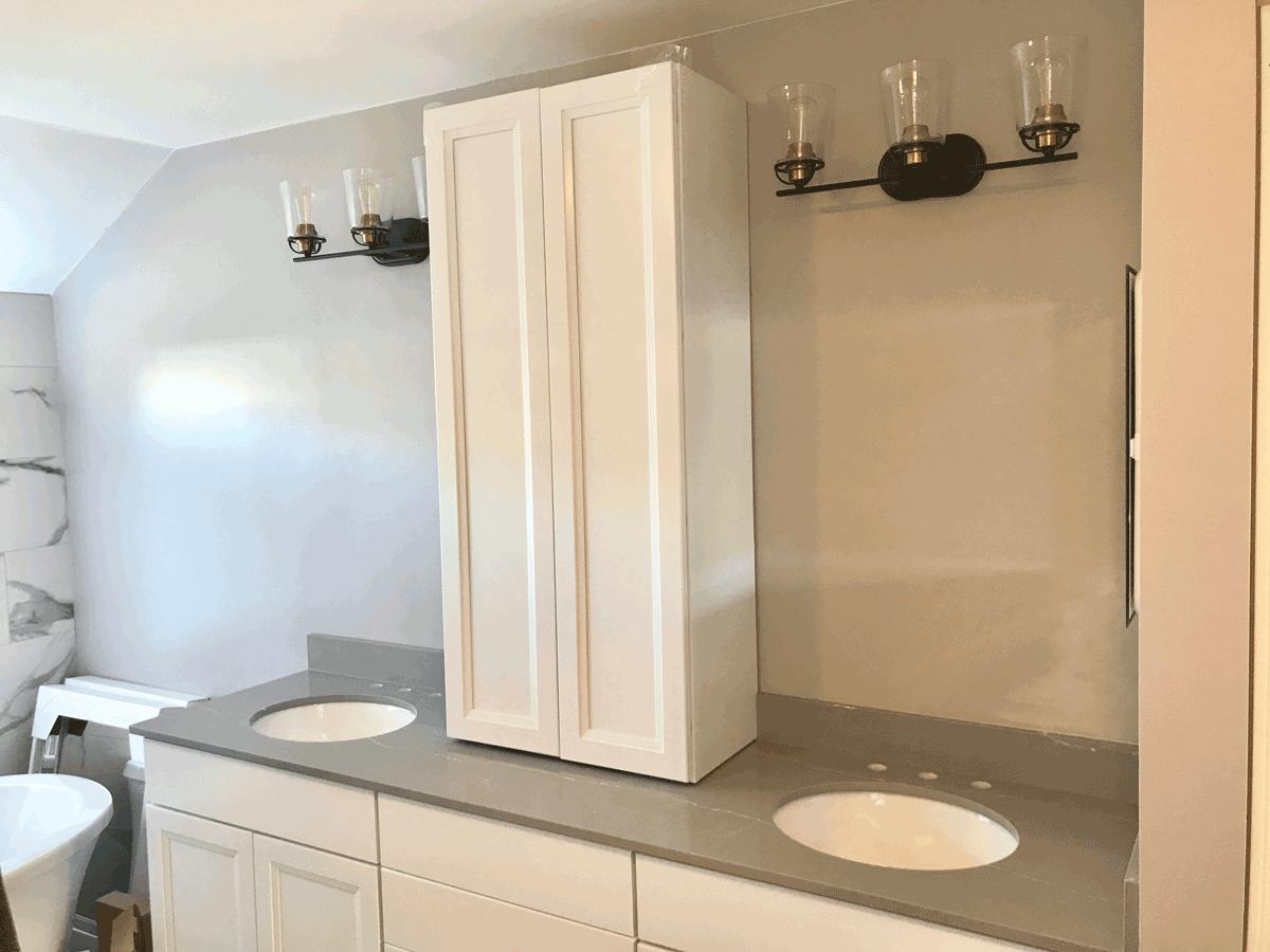 white vanity tower gray countertops master bath