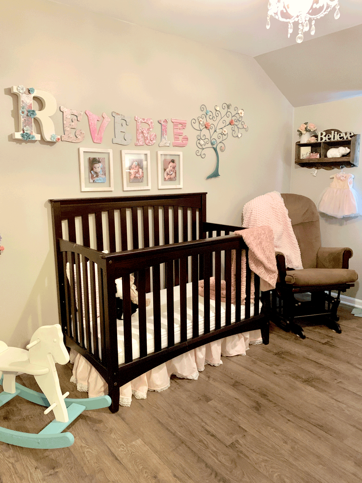 modge podge wooden name letters on wall above crib decorating a girls nursery