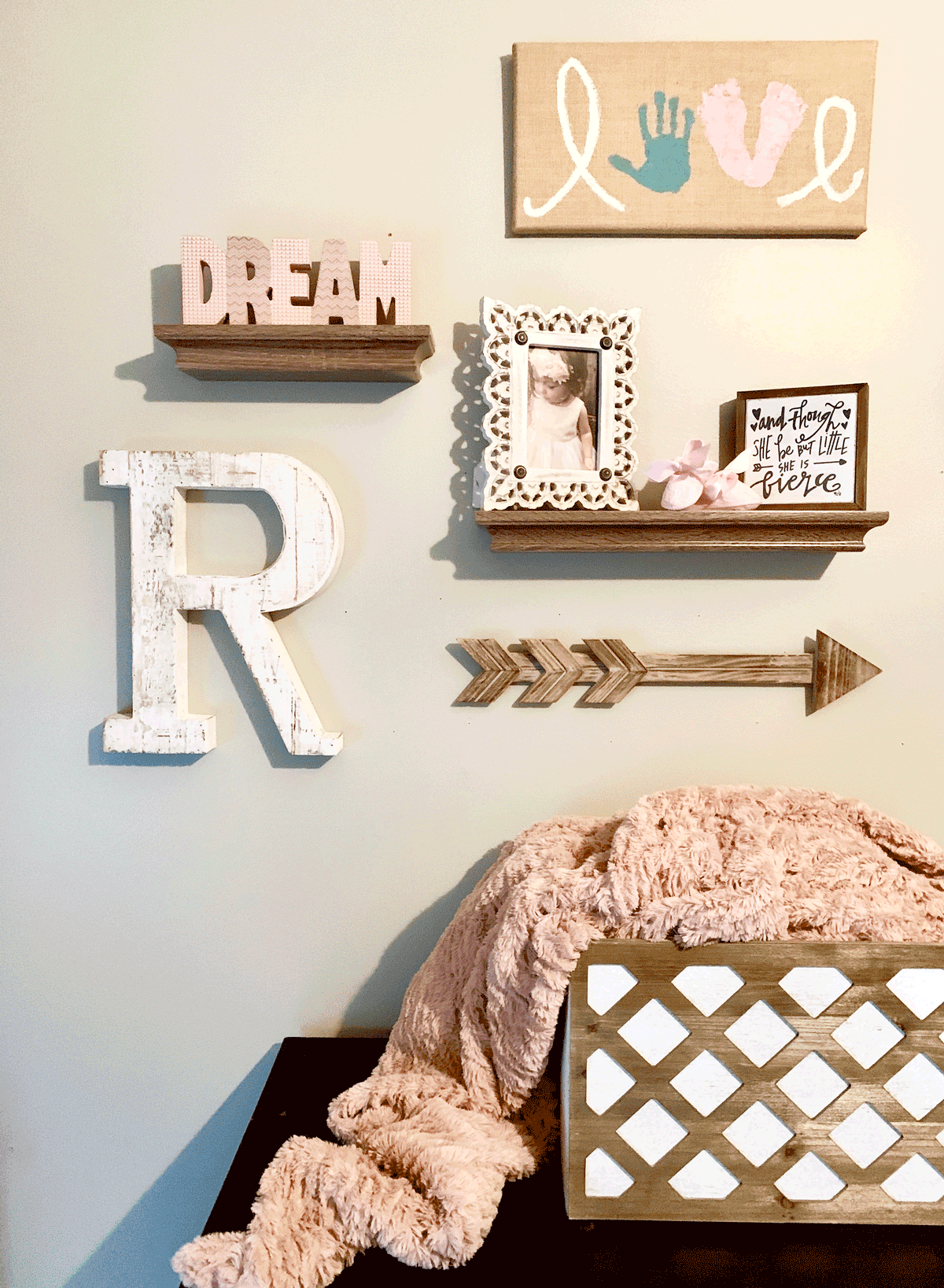 wooden gallery wall for decorating a baby girls nursery