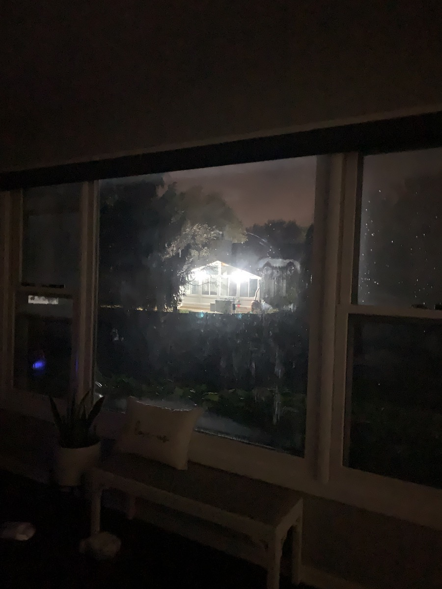blaring lights outside of living room window