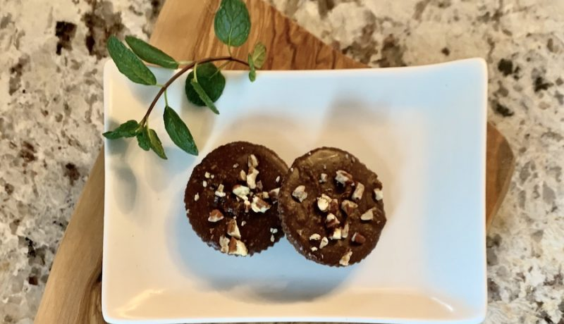 chocolate pb bombs on white plate with mint leaf
