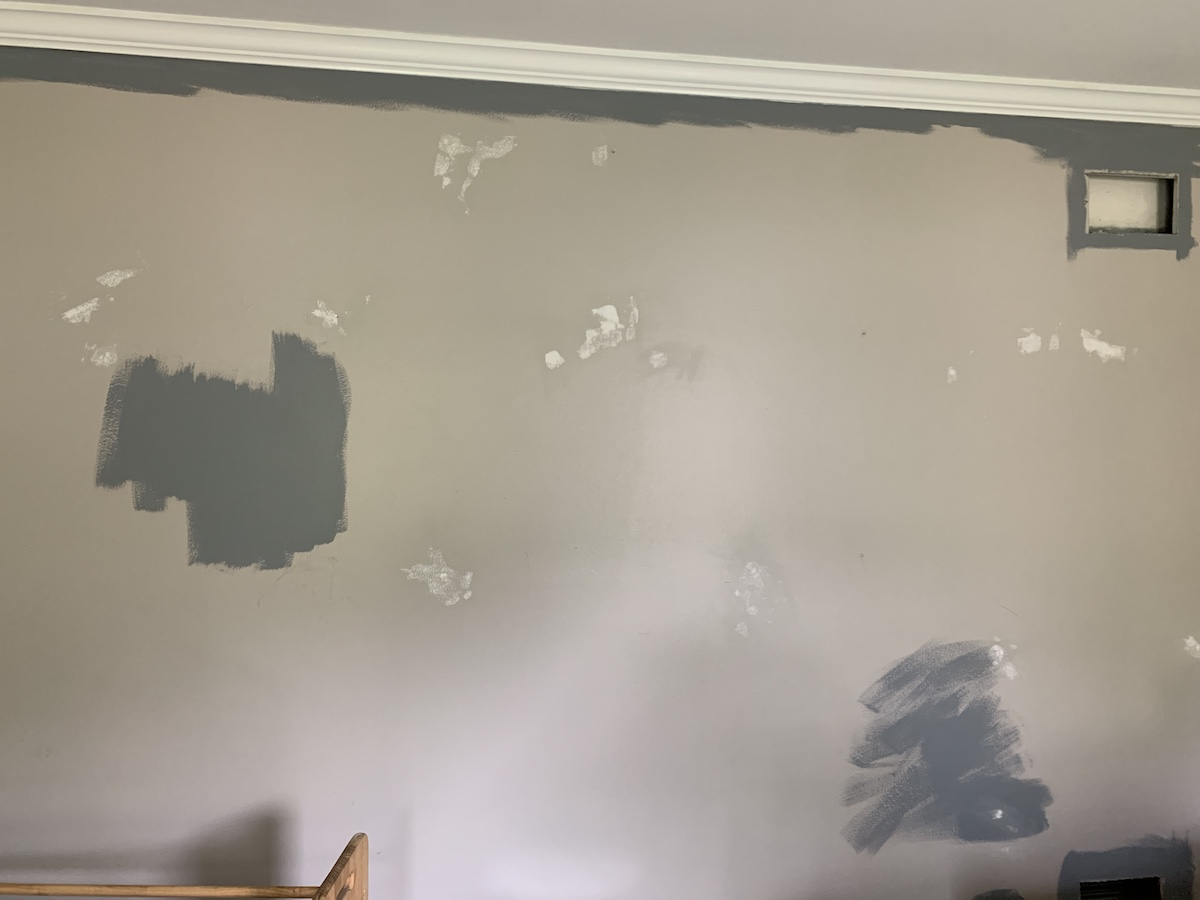 patching holes with spackling compound