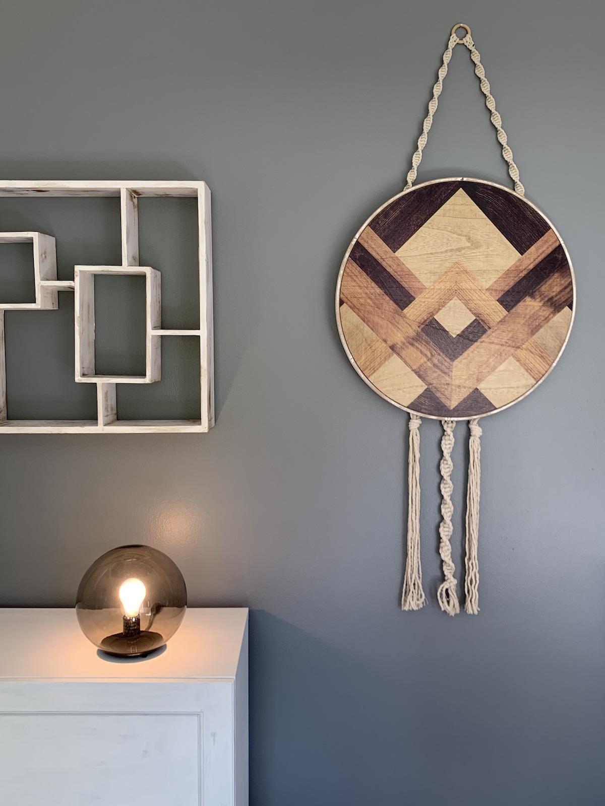 globe light with maze shelf and boho wall hanging