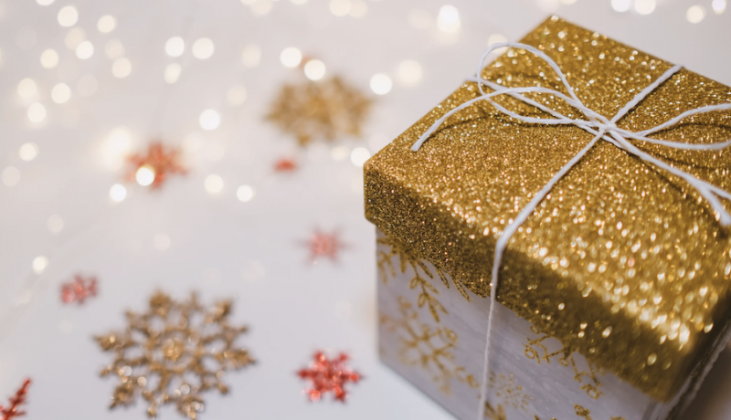 gold present with sparkling snowflakes what women really want
