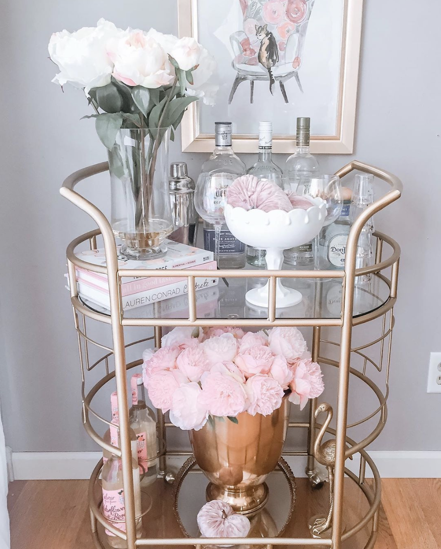 copper and pink decorated bar cart