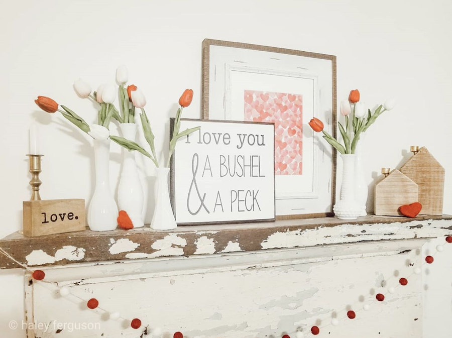 fireplace mantle styled with hearts