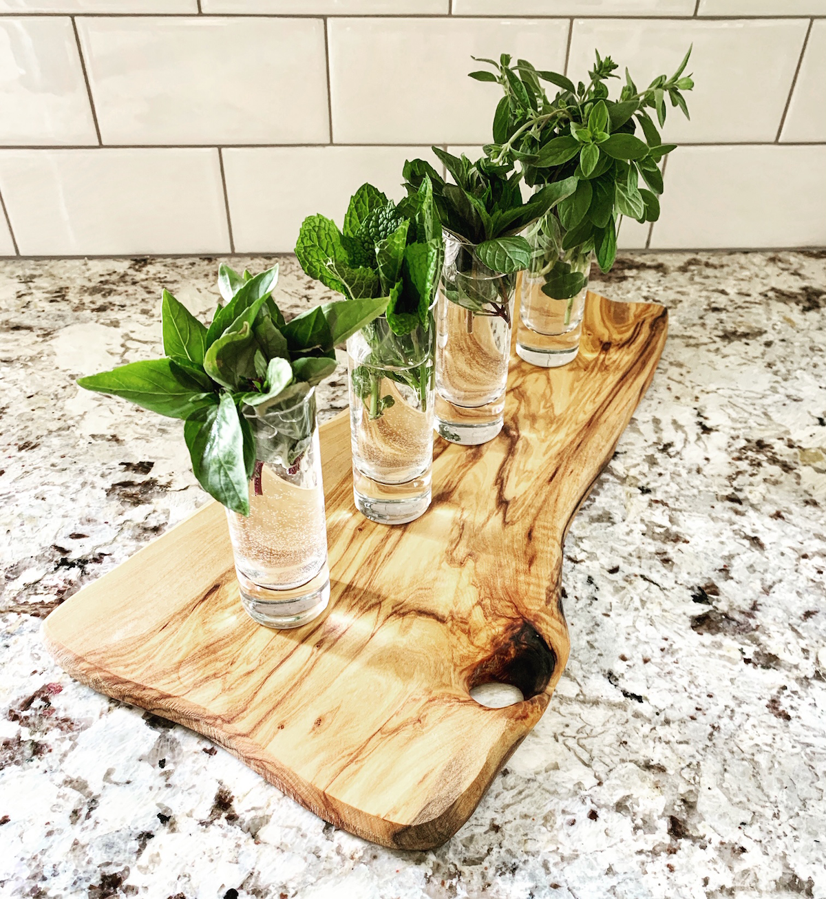 cut herbs from plant wall