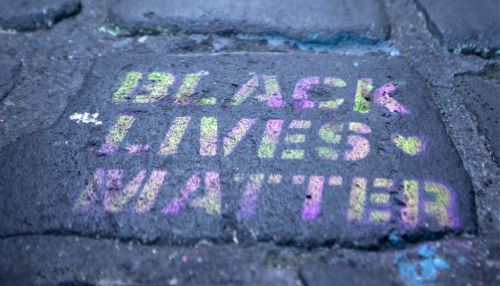 black lives matter on sidewalk