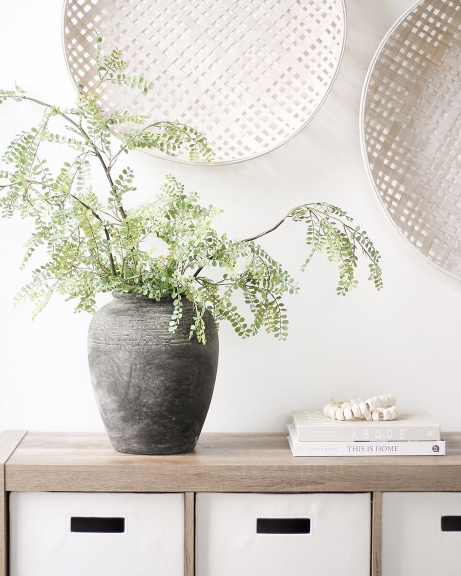 natural wood bookshelf with white baskets