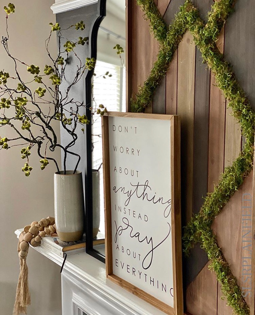 wooden artwork with moss attached