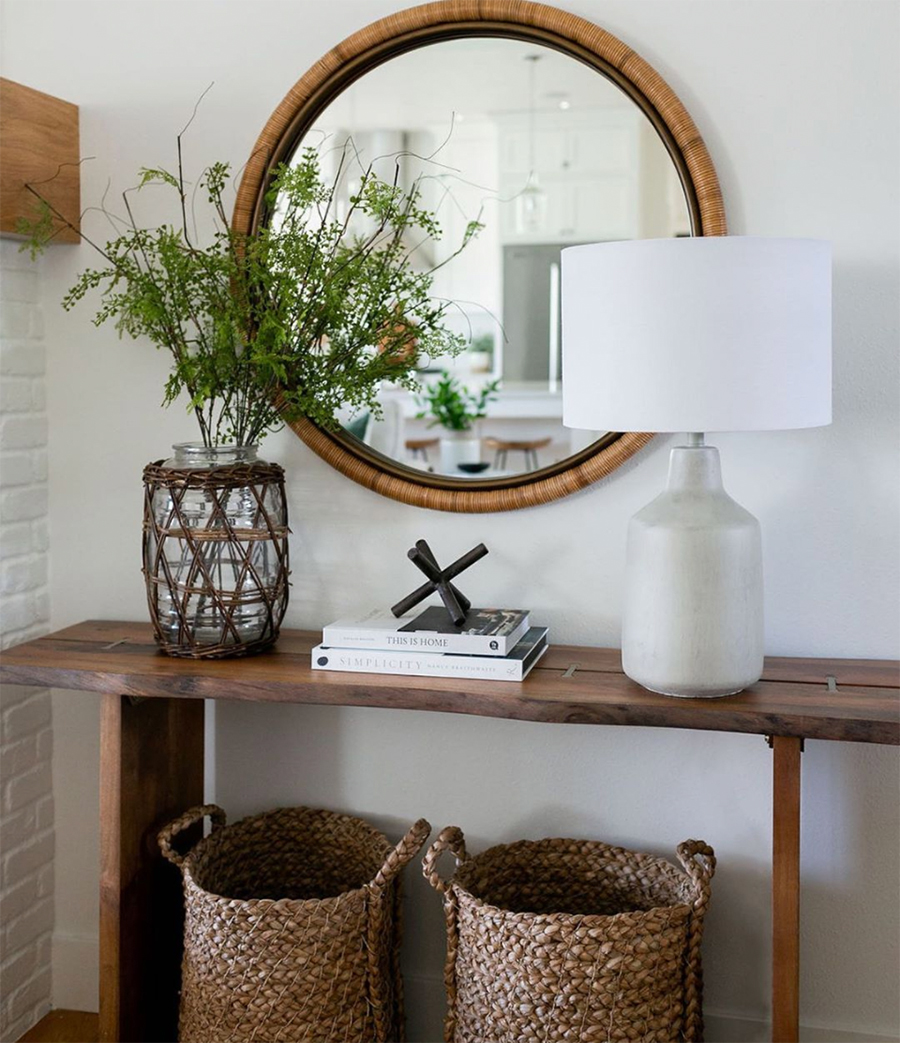 entryway table with woven baskets and mirror with woven frame