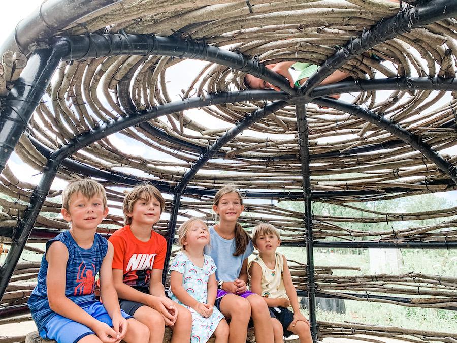 stick hut for kids at bison's bluff playground