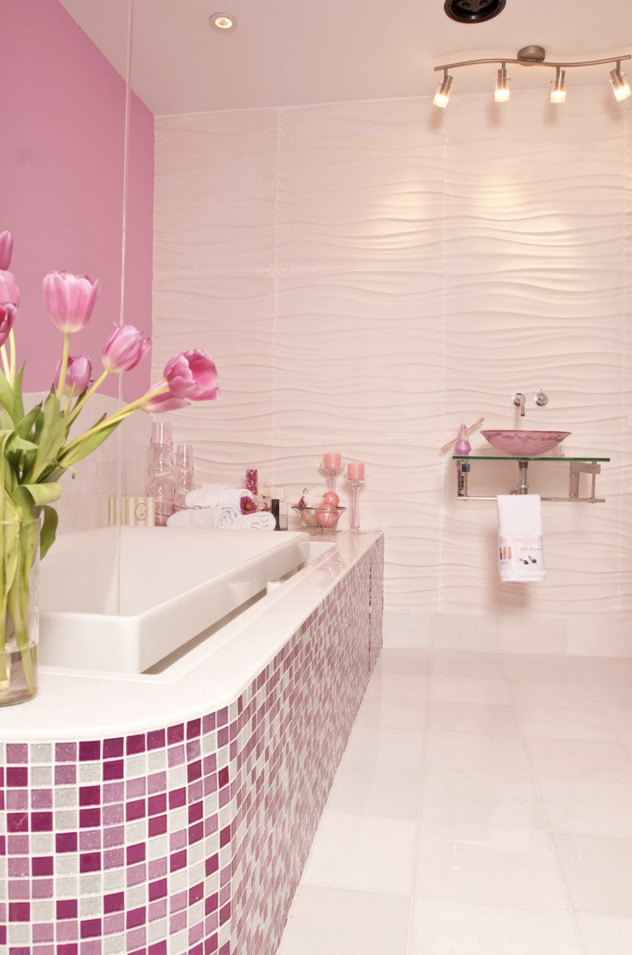 pink tiled bathroom with pink accent wall