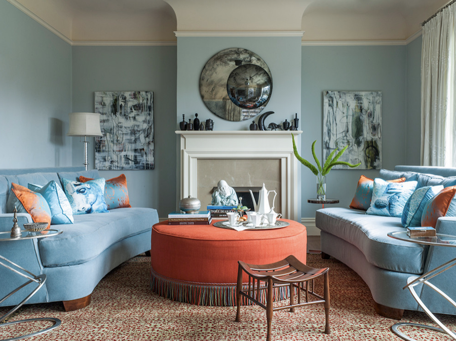 soft blue living room with coral ottoman