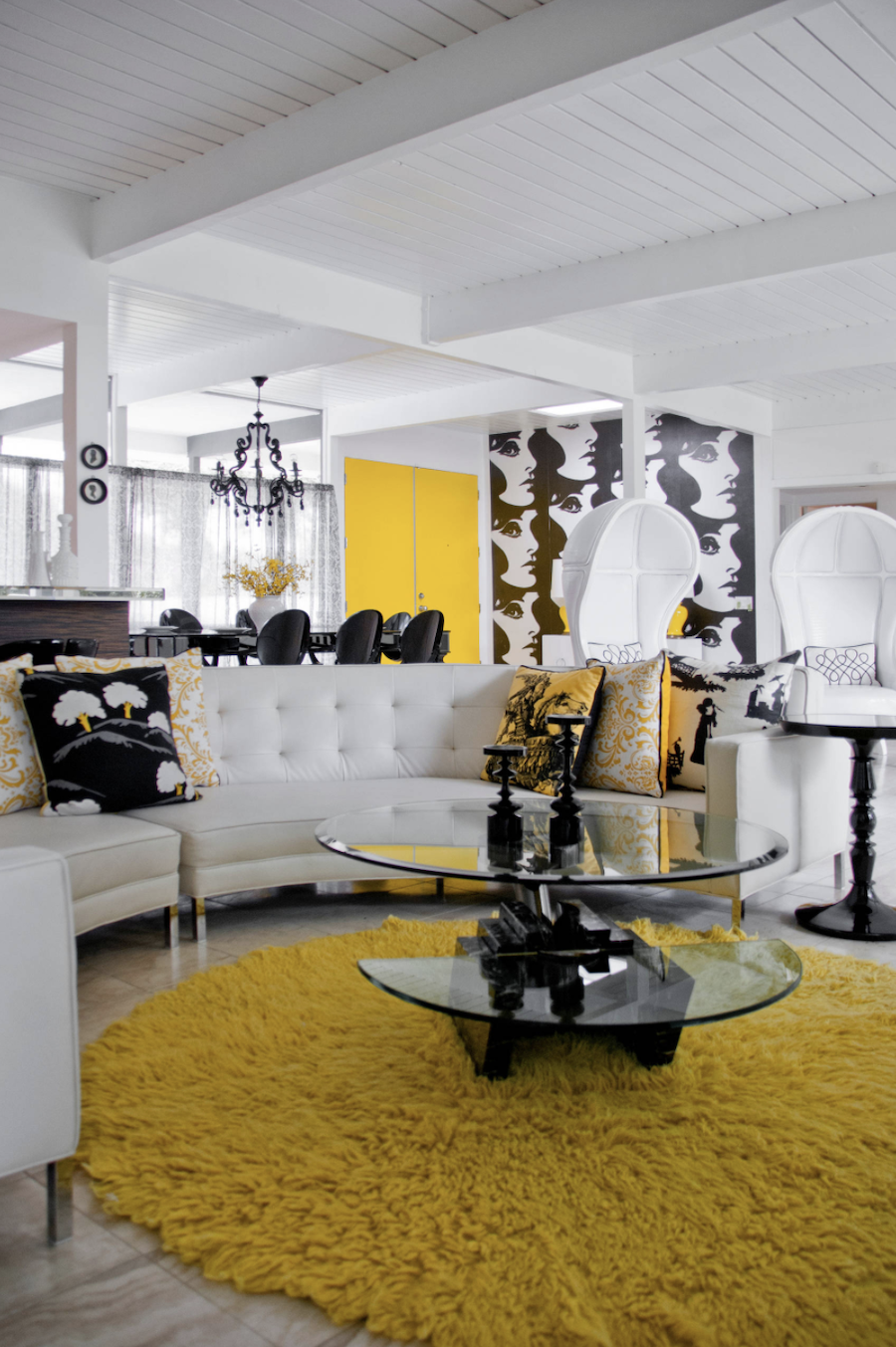 yellow accents in black and white living room