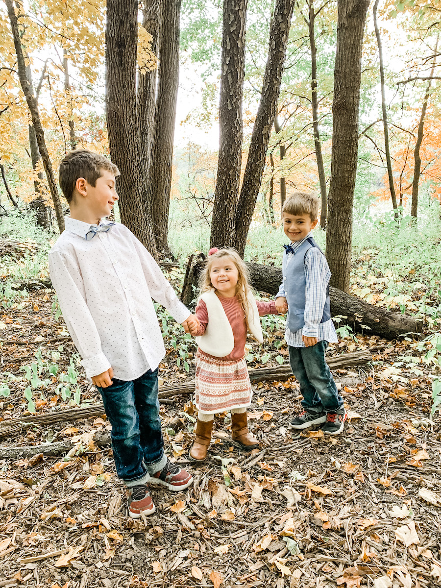 fall family photos with three kids in coordinated outfits