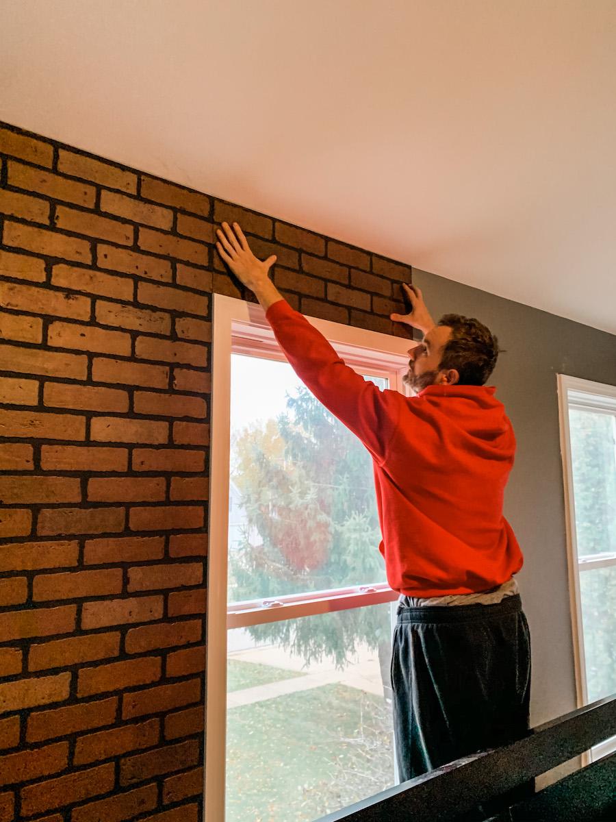 adding faux brick wall panels above window