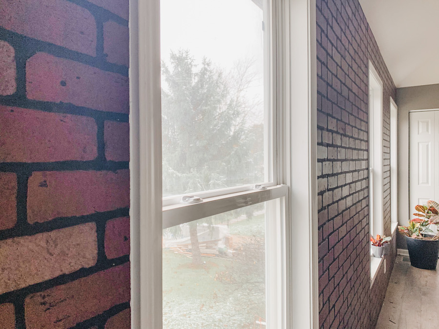 full accent wall of faux brick panels