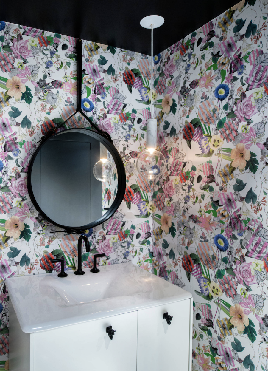 modern bathroom matte black fixtures with purple floral wallpaper