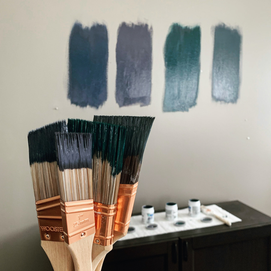 paint swatches painted on walls with paint brushes