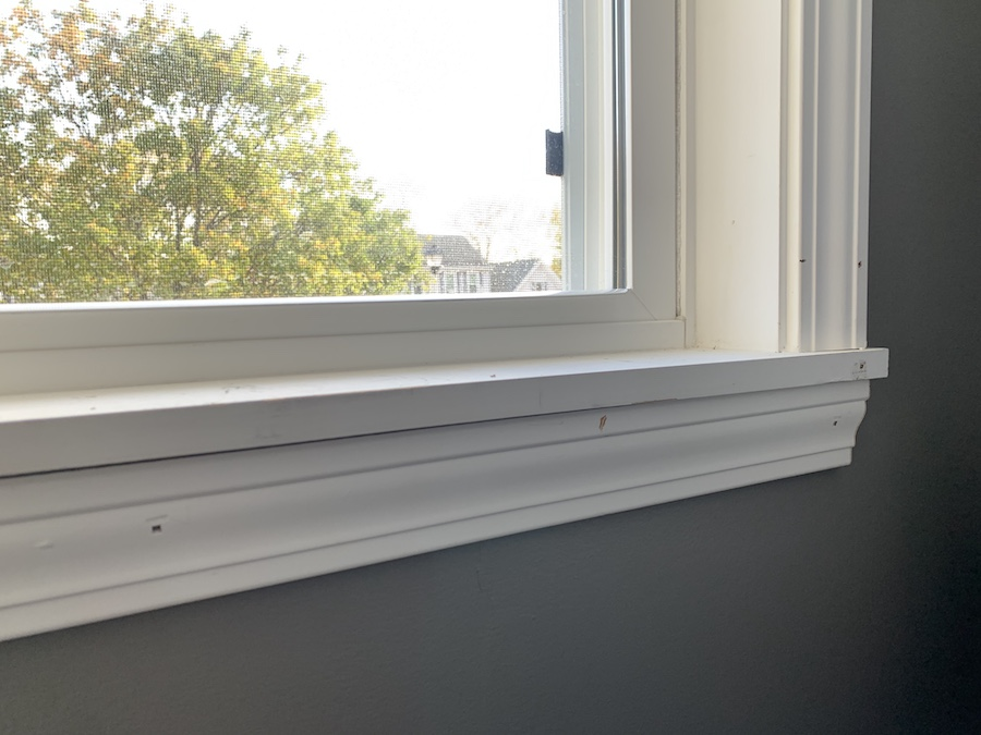 brand new window trim with nail holes to fill