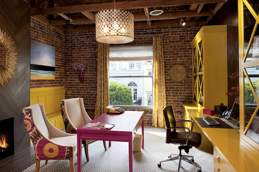 home office with yellow built-in bookcases