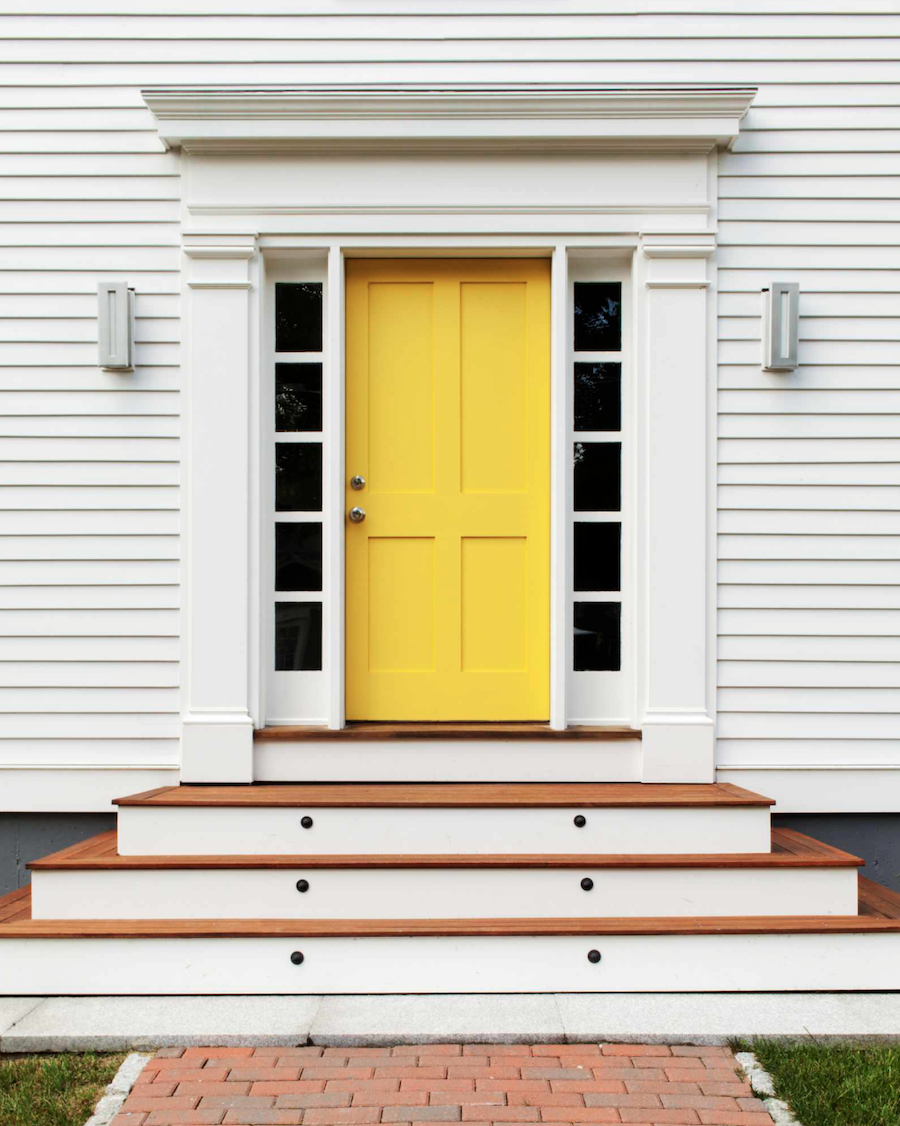bright yellow front door on white house