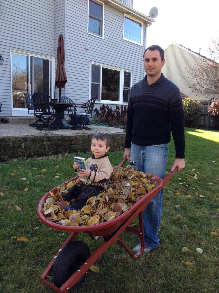 child rides in wheelbarrow