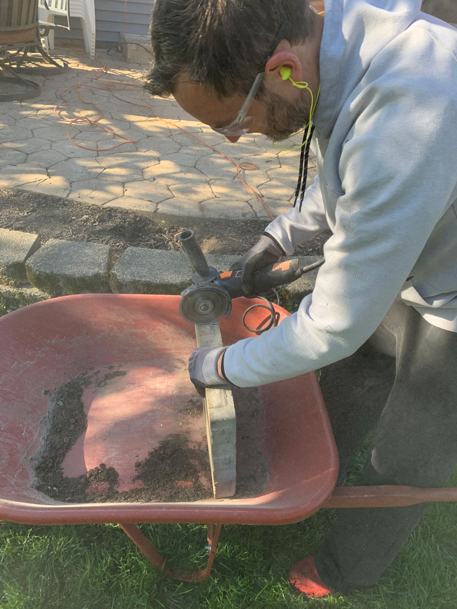 cutting the notch for the pipe into the paver