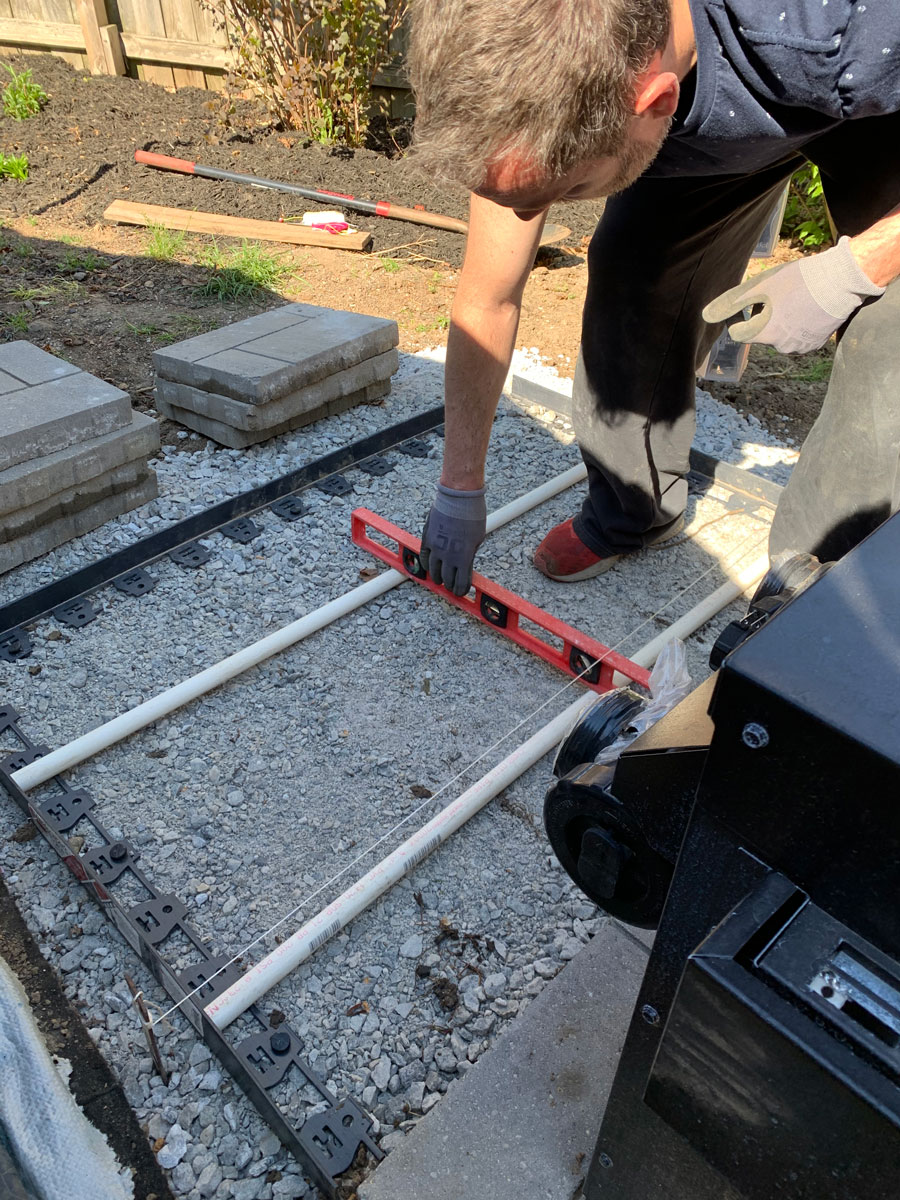 adding pvc pipes for leveling sand
