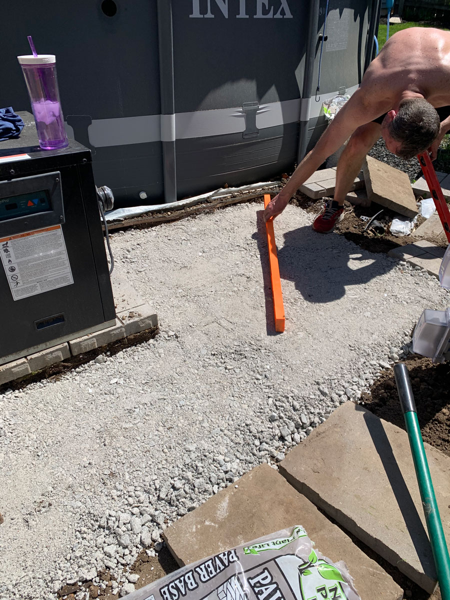 using level to check paver base after stamping