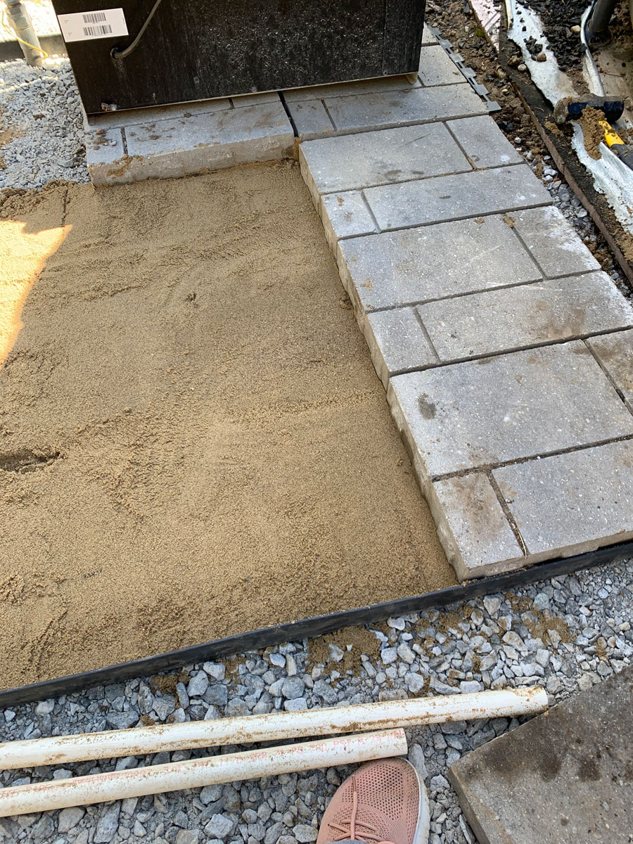 the finished sand leveled for paver patio