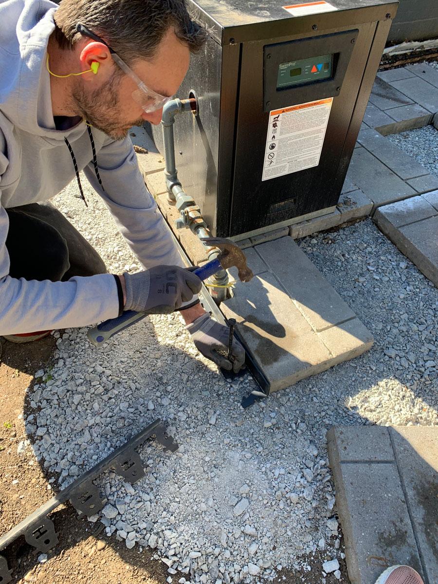 installing trim around the pavers