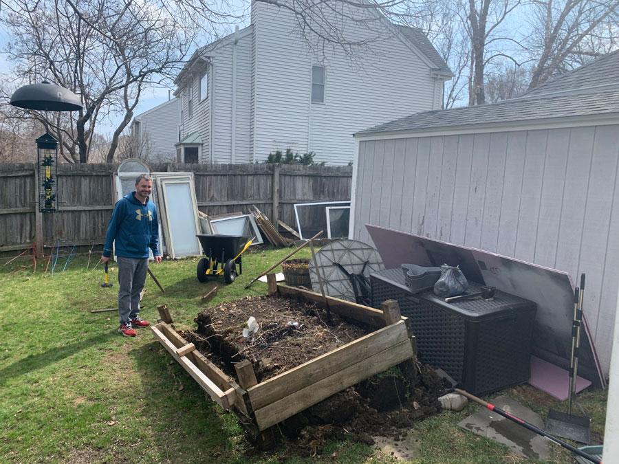 removing the raised garden for the backyard makeover
