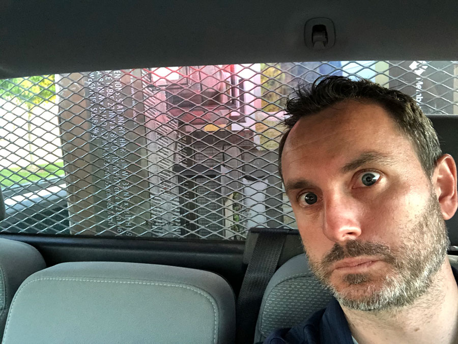selfie in truck with patio furniture in back