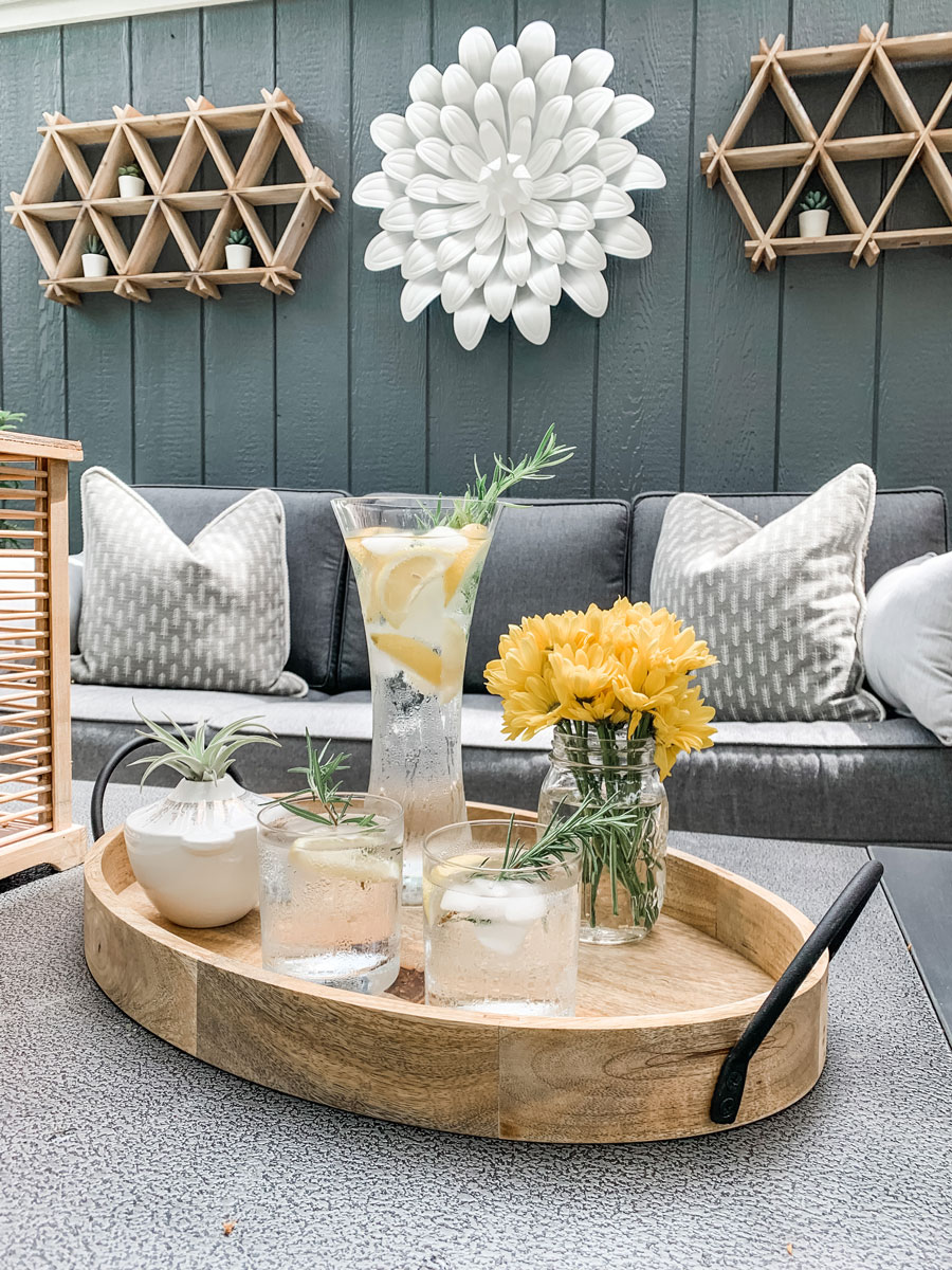 infused water on coffee table of patio revealing the backyard makeover