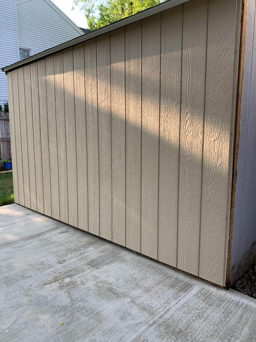 new fiber panels replace shed walls