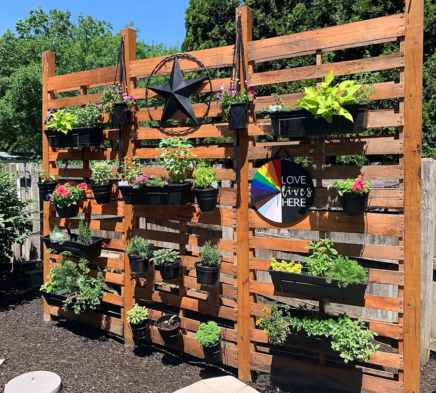pallet wall garden for herbs and flowers in the backyard