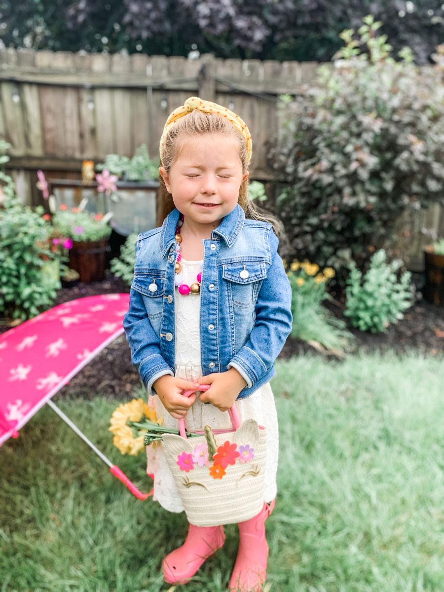 little girl outside in the rain