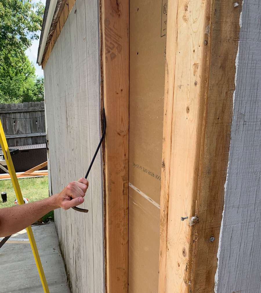 removing shed paneling to replace shed walls
