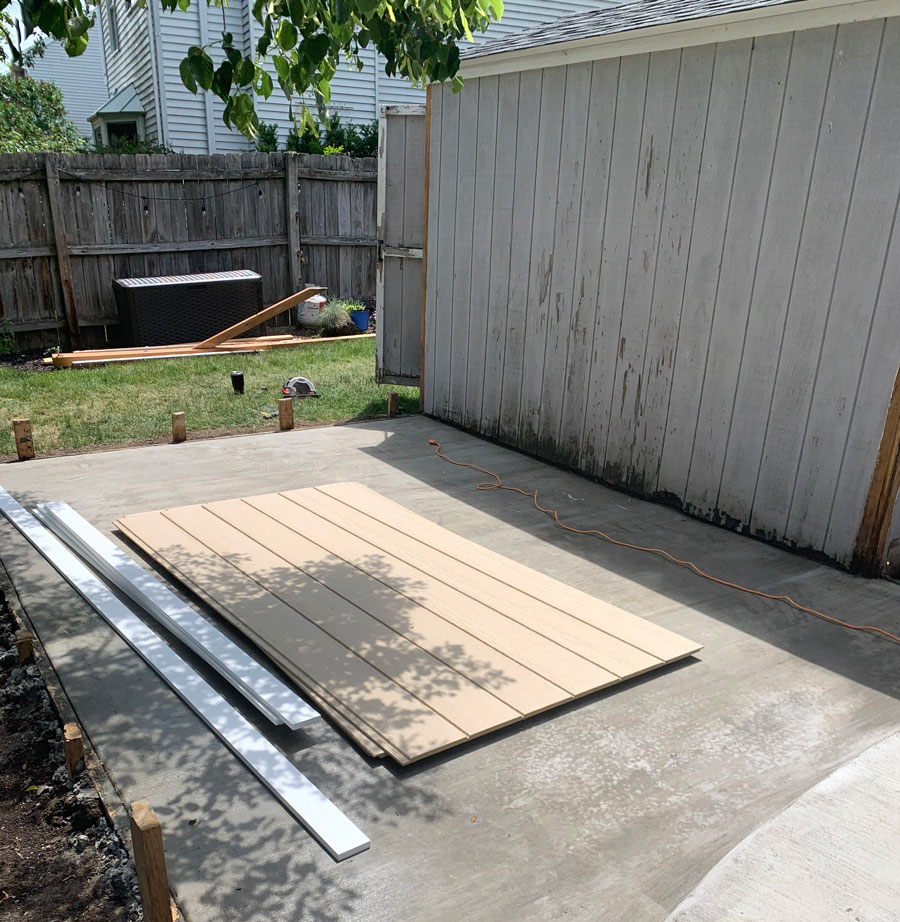 replace shed walls and trim with non-wood materials