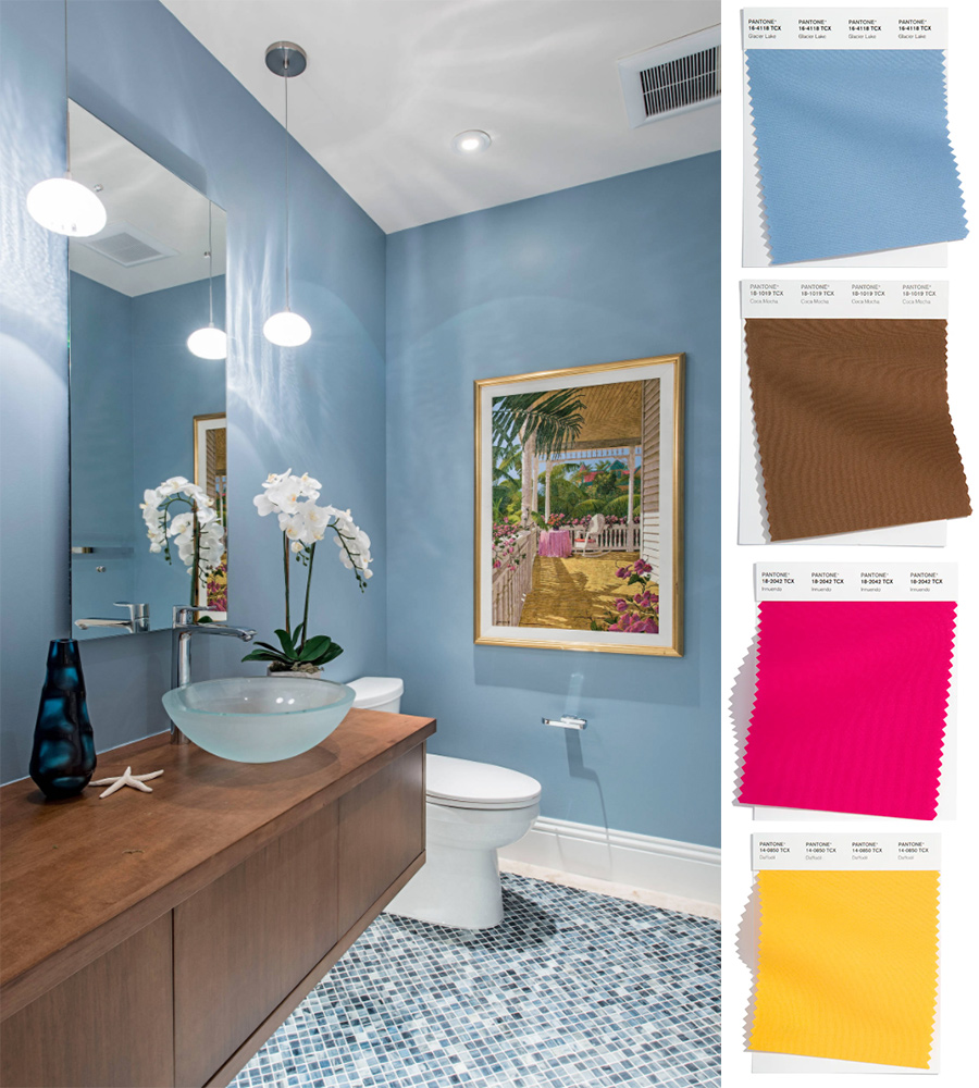 blue tiled bathroom with brown bcabinet