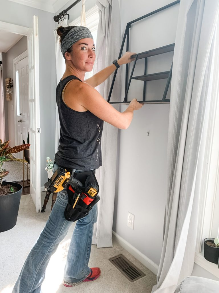 using special no cry tool belt to hang wall shelving