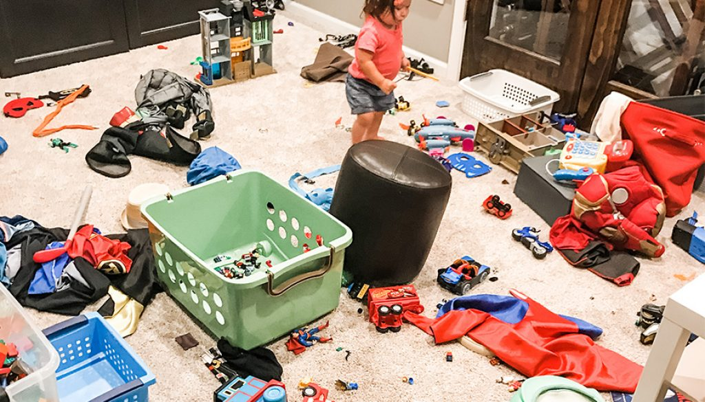 basement full of messy toys needing help from a professional organizer