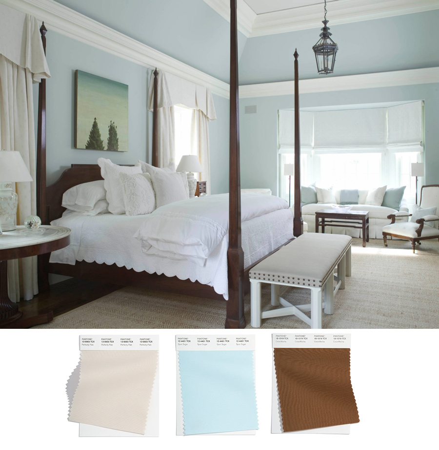 light blue bedroom with dark four poster bed