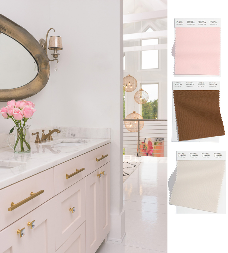soft pink bathroom with brown accents and gold hardware